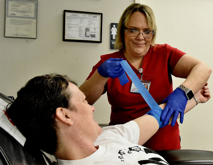 After donating blood at Blood Assurance's donor center in Cartersville Monday, Linary Kingdon has her arm wrapped by Blood Assurance Donor Care Specialist Lora Richardson.