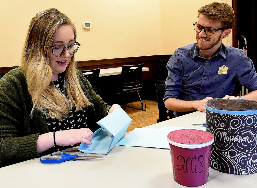 Bartow History Museum's Paige Jennings and Camden Anich prepare materials for Monday's half-day camps for kids ages 5 to 10 at the museum.