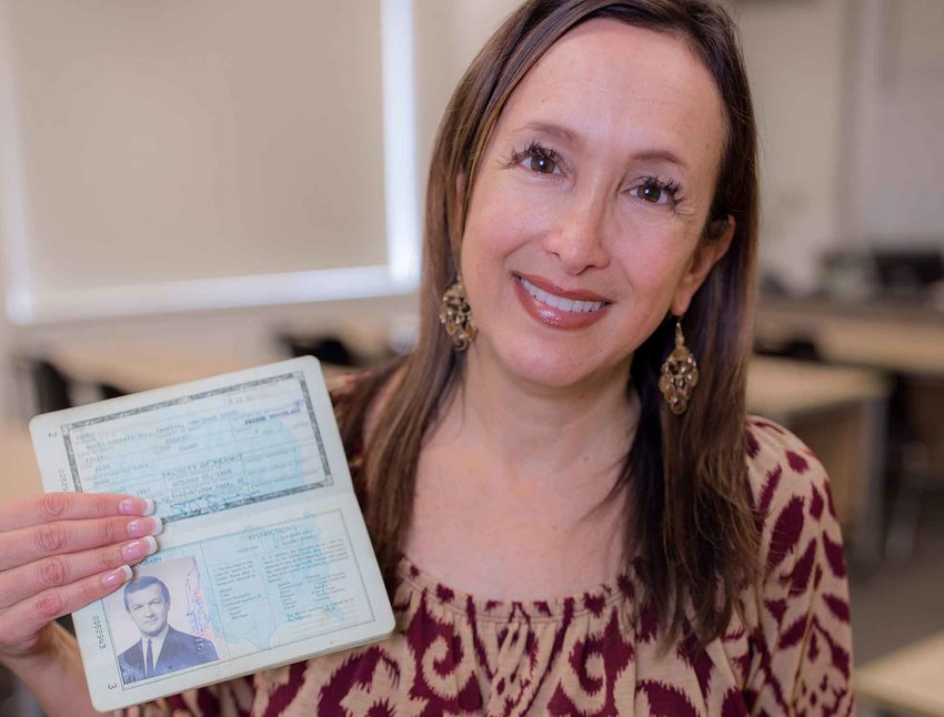 Alexandra Van Ryn MacMurdo Reiter, assistant professor of communication at Georgia Highlands College, shows her grandfather Stefan Ryniewicz's passport.
