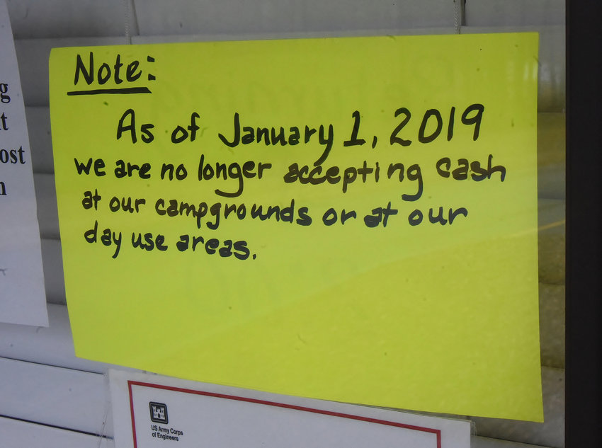 A hand-written sign on the window of the gatehouse at McKinney Campground in south Bartow County advises campers that cash is no longer being accepted at U.S. Army Corps of Engineers' Allatoona Lake campgrounds or day use areas.