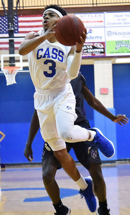 Cass senior Jordan Ford floats toward the basket during Friday's home game against Hiram. Ford had eight points for the Colonels in an 84-49 win.