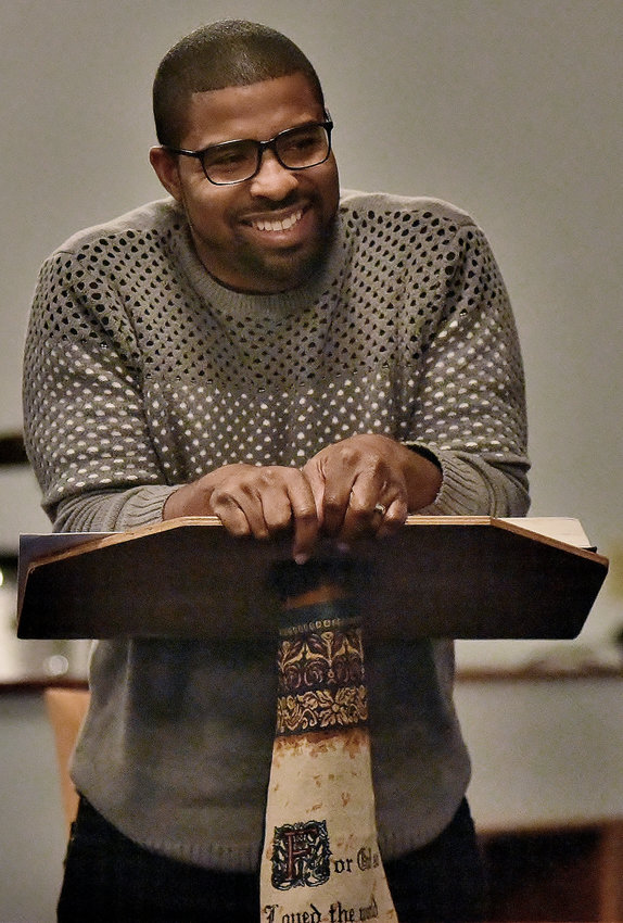 The Rev. Isaiah Robertson, whose grandfather the late Rev. Marvin T. Robinson was friends with Dr. Martin Luther King Jr., leads a Bible study at Macedonia Missionary Baptist Church in Cartersville Wednesday.