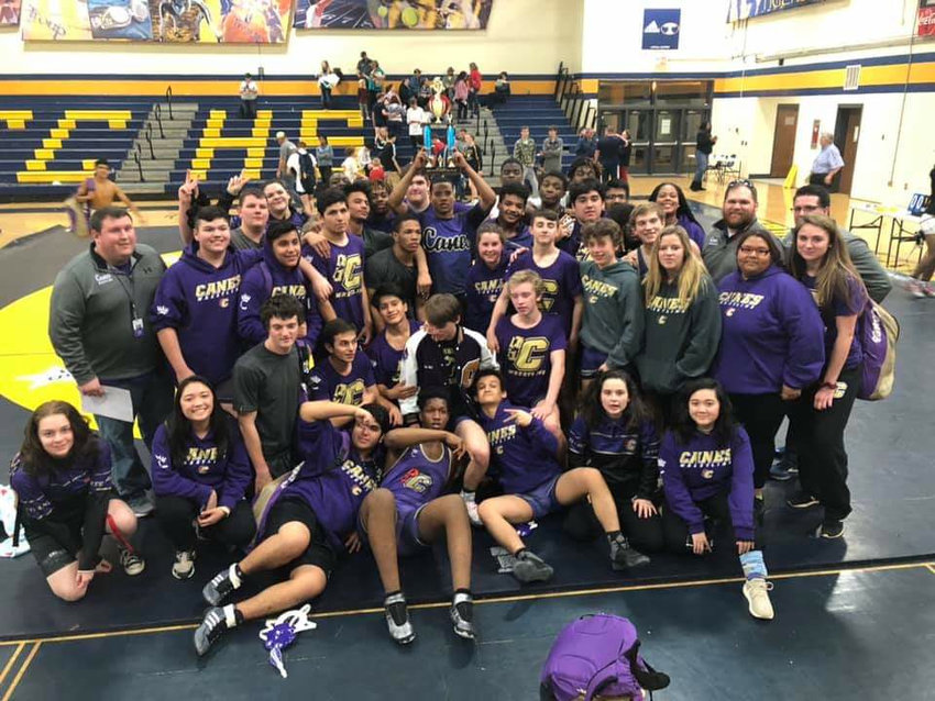 Cartersville wrestling celebrates a first-ever berth in the state duals tournament after finishing second in the Region 5-AAAA area duals on Friday at Troup County.