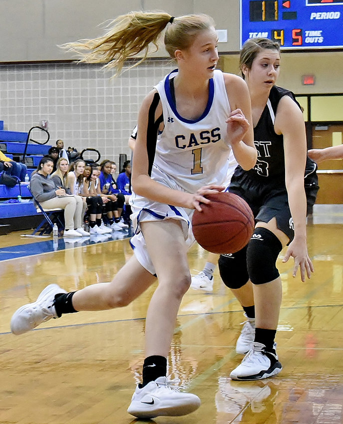 Cass freshman Claire Davis drives to the basket during Saturday's home game against East Paulding. Davis finished with 16 points in an 82-38 win for the Colonels.
