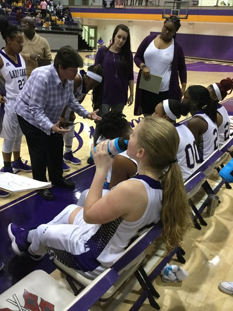 Cartersville girls head coach Cindy Moore talks to her team during a break in the action Friday at The Storm Center. The Canes fell 48-36 to visiting Troup County.