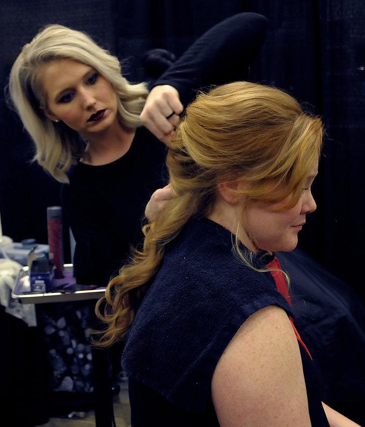 Lauren Wade of Melissa's Hair Beauty & Health Salon styles Kaitlen Arnett's hair.