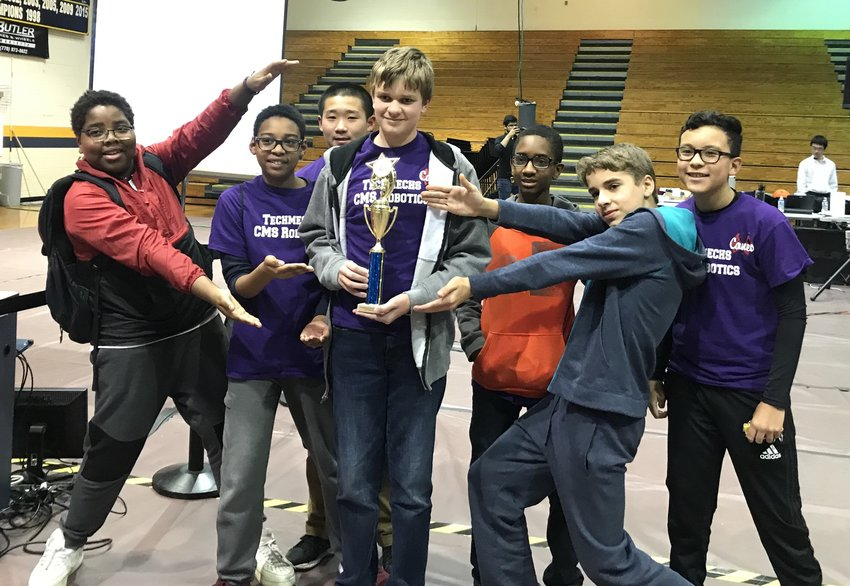 Showing off their first-place core values trophy at the Circuit Runner Super-Regional last weekend are Team 2 members, from left, Jason Charles, Mason Coleman, Anthony Zhang, Max Langston, Bryan Thomas, Noah Crisp and Victor Lopez.