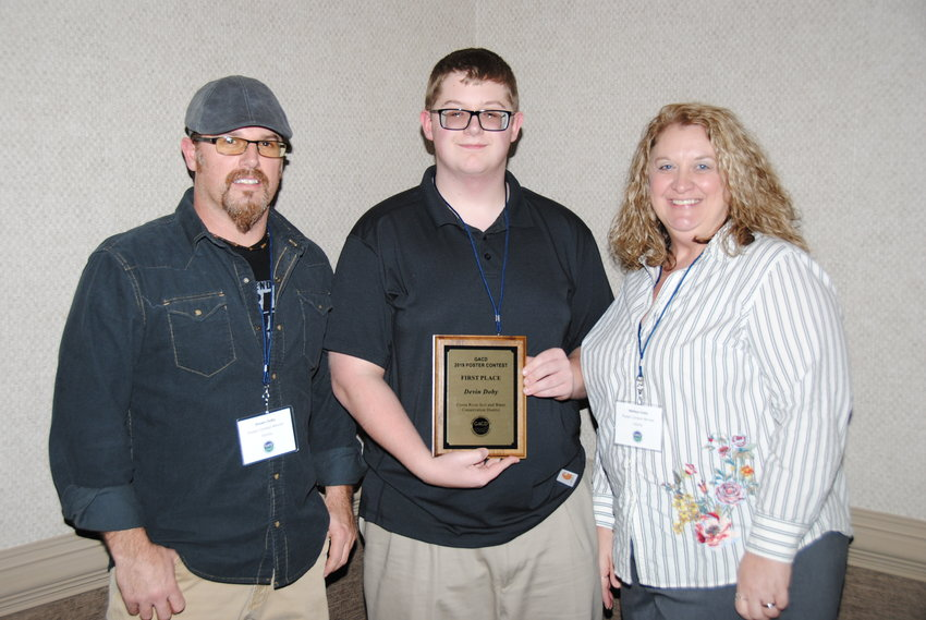 Devin Doby, with his parents, Shawn and Melissa Doby of Adairsville, was the state winner of the National Association of Conservation Districts' Photo Contest.