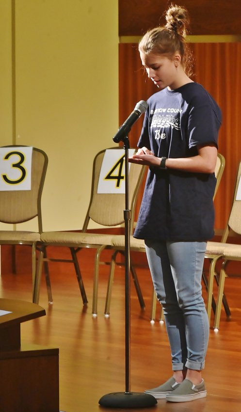 "Woodland Middle School eighth-grader Addison Payne spells ""plausible"" to win the 2019 Bartow County Spelling Bee Friday at the Clarence Brown Conference Center."