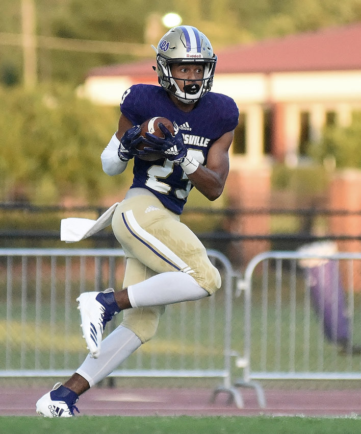 Cartersville senior wide receiver Kaleb Chatmon hauls in the game's first touchdown against Luella this past season. Chatmon is the only football player in Bartow County expected to sign his national letter of intent on national signing day. He recently committed to Charleston Southern University, where he will join former Canes coach Antwan Toomer.