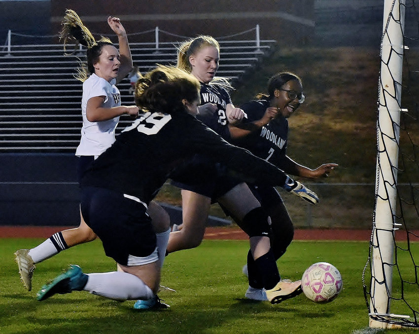 Woodland's Abigail Carlsen, center, pushes home the Lady Wildcats' only goal in their 3-1 loss in their home opener Thursday against Heritage. The loss drops Woodland to 0-2 on the season. The Woodland High boys, though, picked up a win over Heritage by a final score of 5-2, with Rene Vazquez and Raul Gonzales each scoring two goals. The Cass High girls team, meanwhile, earned its first win of the early season Thursday night to move to 1-1. The Lady Colonels defeated Southeast Whitfield 6-1, behind a hat trick from Logan Vermaas. The Cass boys lost to Southeast Whitfield 6-0 and are now 1-1 on the year.
