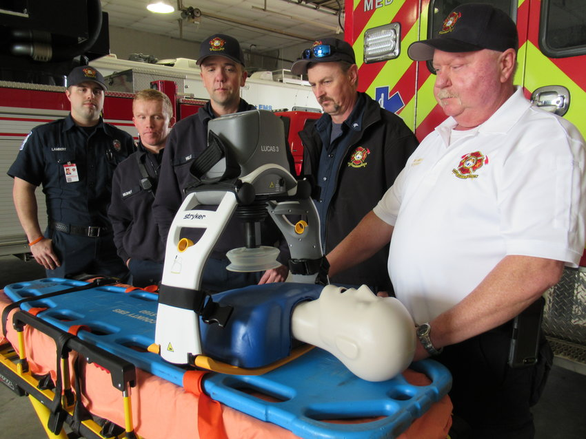 From left, Bartow County Fire Department personnel Brandon Lambert, Kevin Bilbrey, Kam Willis, Scott Hoke and Dwayne Jamison demonstrate how a LUCAS device automatically performs CPR on a medical dummy.