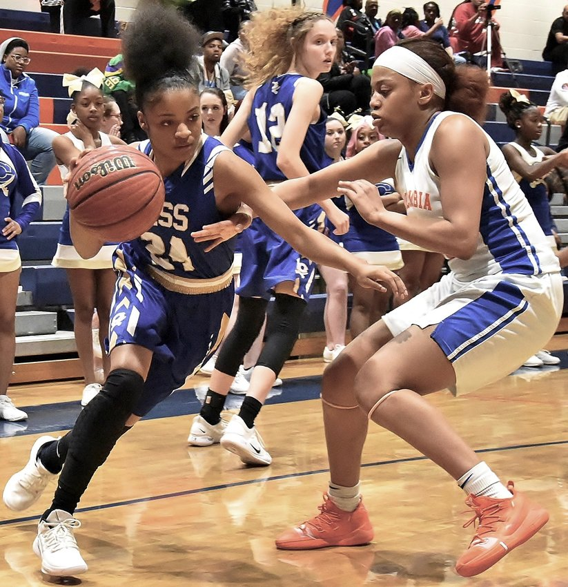 Cass senior Brianna Stephenson drives towards the basket against Columbia during Wednesday's second-round matchup in the Class 5A girls state tournament. The Colonels fell by a 59-43 final score in Decatur to end the season at 22-8.