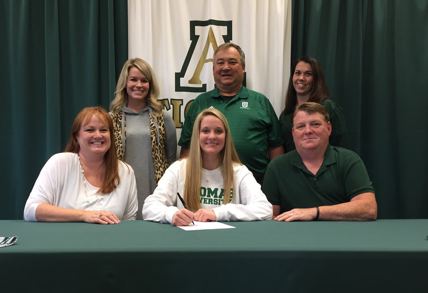 Adairsville senior Sierra Tanner signed her national letter of intent to play softball for Thomas University in Thomasville. On hand for the signing were, from left, front row, Brandy King, mother; Greg King, stepfather; back row, Traci Newman, AHS assistant coach; Ralph Sanders, Thomas assistant coach; and Kandace Bruno, AHS assistant coach.