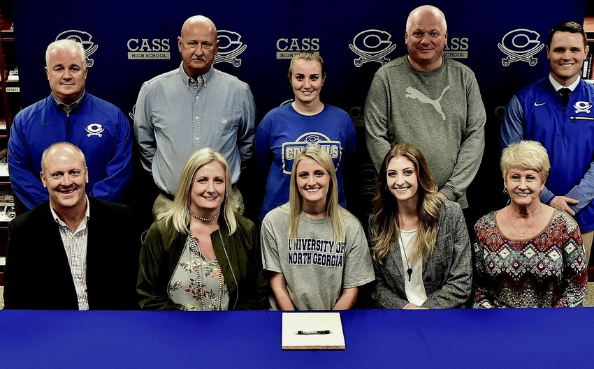 Cass senior Logan Vermaas signed her national letter of intent to play soccer for North Georgia on Feb. 6 in the CHS media center. On hand for the signing were, front row, from left, Lourens Vermaas, father; Anissa Vermaas, mother; Sidney Vermaas, sister; and June Logan, grandmother; back row, CHS athletic director Nicky Moore; CHS coach Phil Phillips; CHS coach Shannon Brennan; travel coach Alex Pana; and CHS principal Steve Revard.