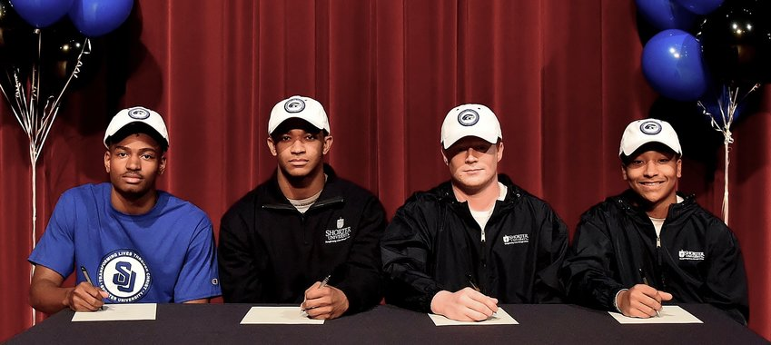 Woodland seniors, from left, Jaylen Ballard, Jalen Hudson, Dylan Forman and Justice Carter signed their national letters of intent to play football at Shorter University in Rome during a ceremony Friday inside the WHS Performing Arts Center.