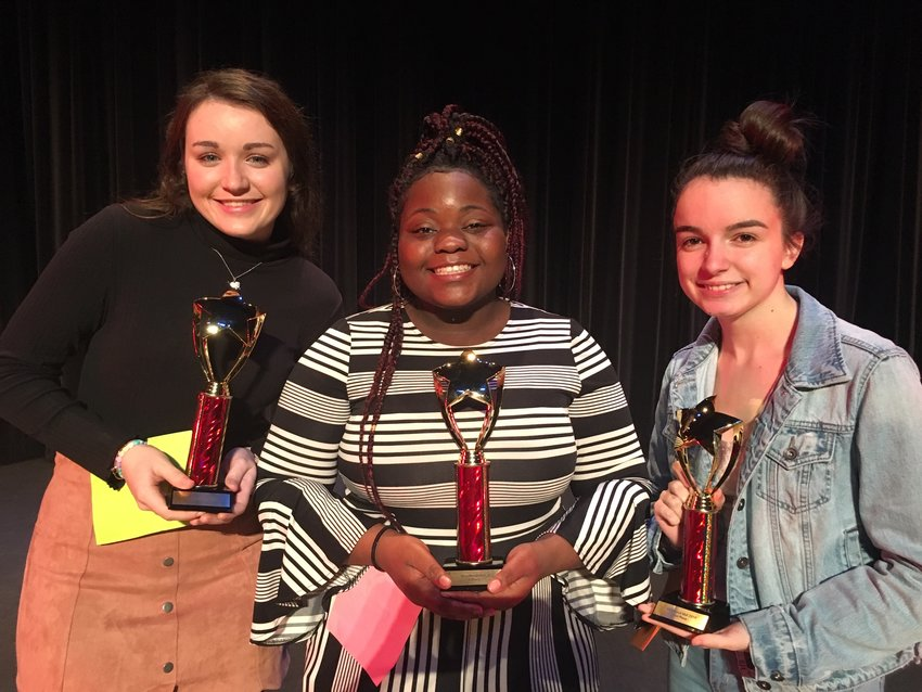 Taking home the Woodland Idol trophies Friday night were, from left, third-place finisher Hope Shultz, winner Honnah Mosley and second-place finisher Alana Murdock.