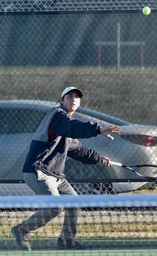 Woodland Line 1 singles player Bryce VanOrder prepares to return a forehand in his match Tuesday at home against East Paulding. VanOrder won his match 6-0, 6-0, as the Wildcats moved to 4-0 in Region 7-AAAAA with a 5-0 win over the Raiders.