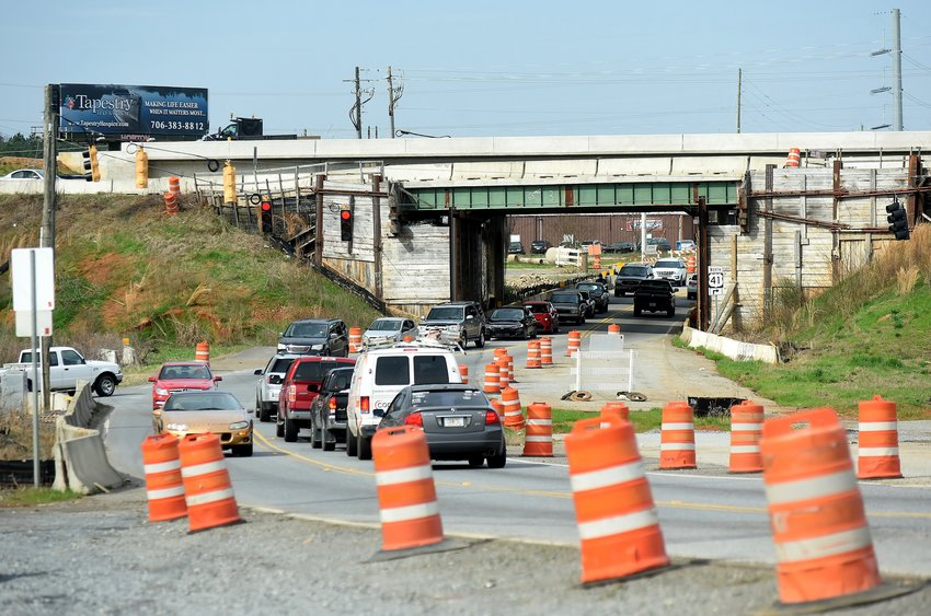 Wet weather has delayed the planned demolition of one of the old Highway 41 bridges over Tennessee Street.
