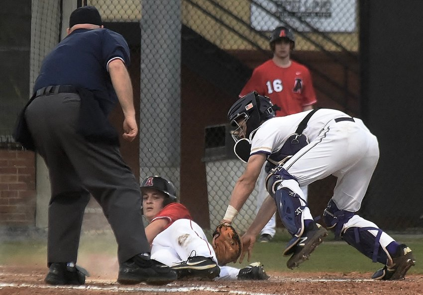 Cartersville catcher J.P. Martin makes the tag at the plate on an Alexander baserunner attempting to score in the Canes' 3-0 shutout win Thursday at Richard Bell Field.