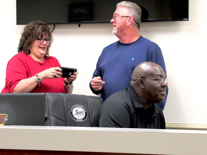From left, Adairsville City Manager Pam Madison, Councilman Jerry Towe and Mayor Kenneth Carson gather before Thursday evening's city council meeting.