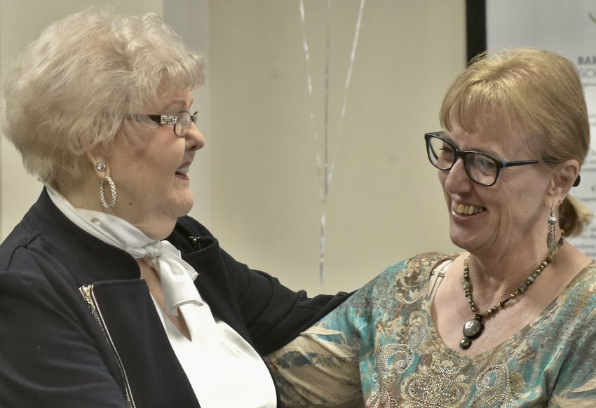 Bartow County Schools Director of Nutrition Services Pam Blakeney, right, shares a laugh with Dot Frasier, executive director of the Bartow Education Foundation, at Blakeney's retirement party March 12.