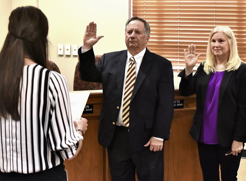 Cartersville City School Board members Tim Chason and Kathi White take the oath of office administered by Cartersville City Clerk Meredith Ulmer before Thursday's called meeting.