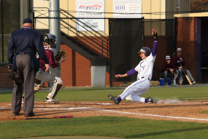 Cartersville senior Preston Welchel slides safely into home to score on Jordan Wilkie's RBI hit in Tuesday's 12-1 win over Central-Carroll. Welchel and Wilkie each finished 2-for-2 with a walk and three RBIs in the victory.
