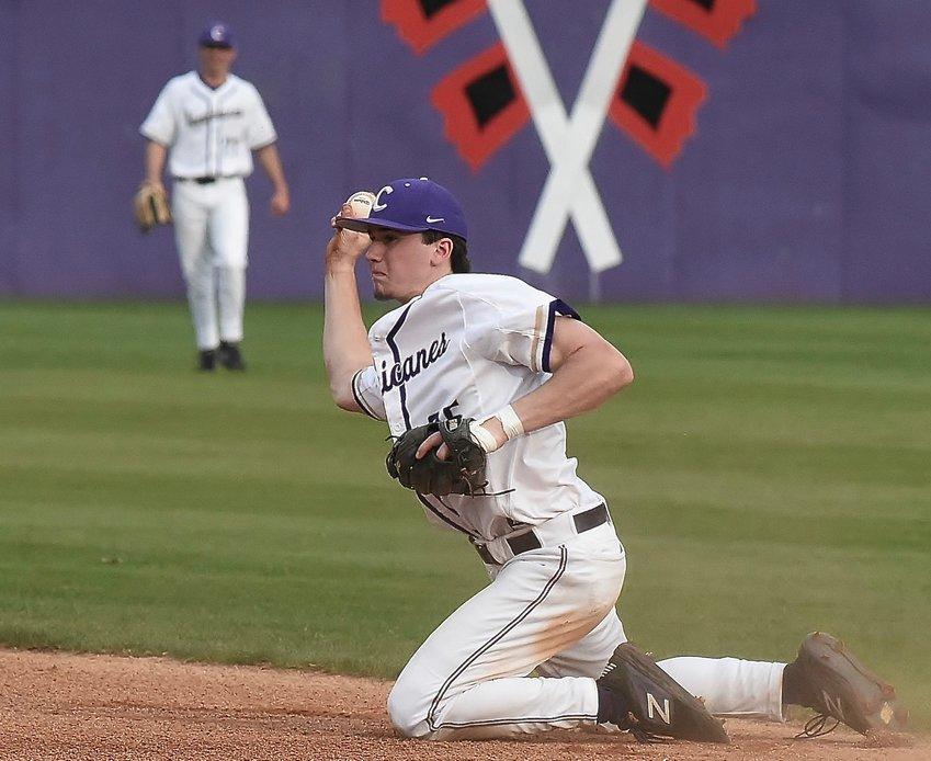 Cartersville junior Josh Davis makes a throw to first base to record an out during Friday's Region 5-AAAA game against Troup County at Richard Bell Field. Davis recorded a walk-off single in the 10th inning to lift the Canes to a 2-1 win.