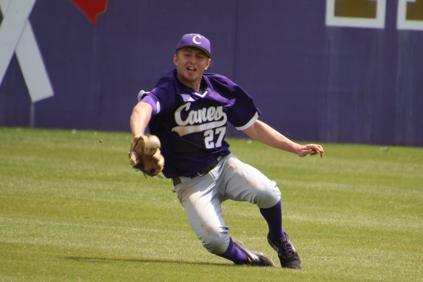 Cartersville senior Preston Welchel is unable to make a sliding catch during Saturday's game at Richard Bell Field. Although the batter reached safely, Canes junior Josh Davis quickly corralled the ball and threw to second for a forceout, helping Cartersville hold off a late comeback bid by Maryville (Tennessee) in an eventual 3-1 win.