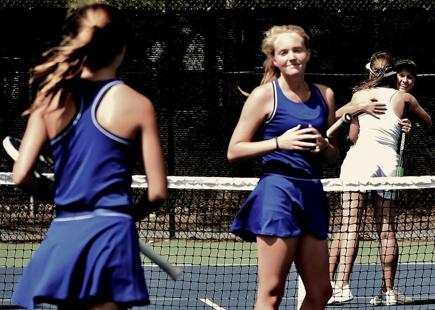 The Cartersville Line 1 doubles team of Alice Terry, far right, and Lydia Wiedetz hug after winning their match over LaGrange Thursday at Dellinger Park. The victory earned the Canes a 3-2 win, a Region 5-AAAA championship and a No. 1 seed in the Class 4A state tournament.