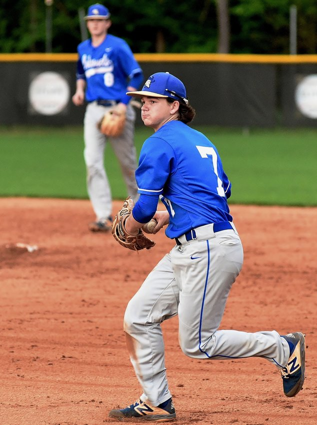 Cass second baseman Matt Shook prepares to throw out an East Paulding baserunner at first base during Friday's game at East Paulding.