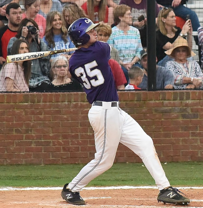 Cartersville junior Josh Davis follows through on his seventh-inning, two-run home run during Wednesday's 5-0 win at Cedartown. Davis finished 3-for-4 with two runs scored and two RBIs to help the Canes capture the Region 5-AAAA championship.