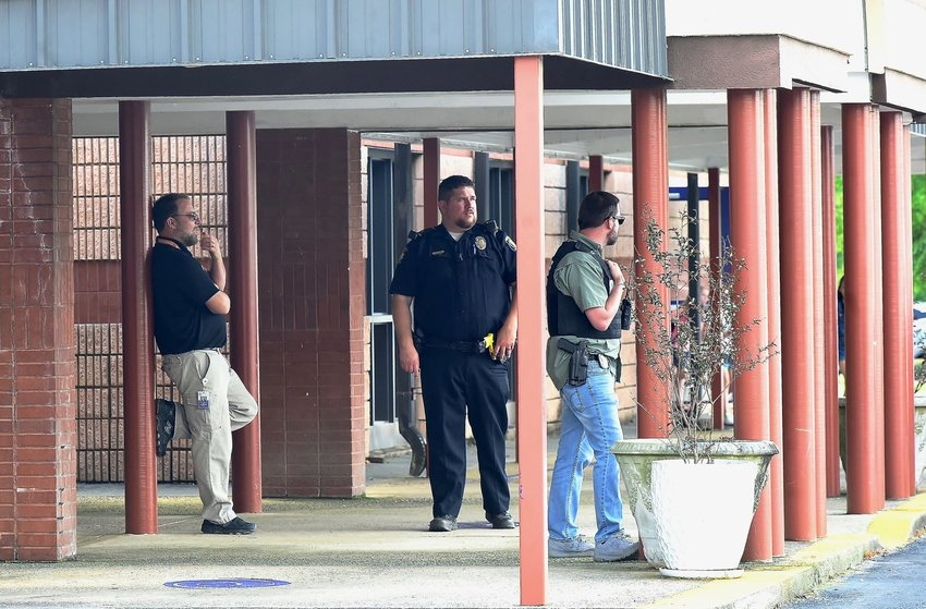 Law enforcement personnel monitor activity outside of Cartersville Elementary School Thursday afternoon shortly after a system-wide soft lockdown was lifted.