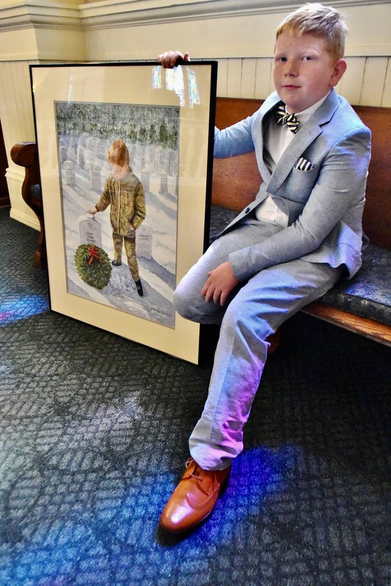 """Simon Nation holds Jodeen Blazer Brown's painting that was inspired from his visit to the Georgia National Cemetery in 2017. The Cartersville artist's """"Freedom Achieved"""" watercolor captured first in painting for National Society Daughters of the American Revolution's American Heritage Contest."""