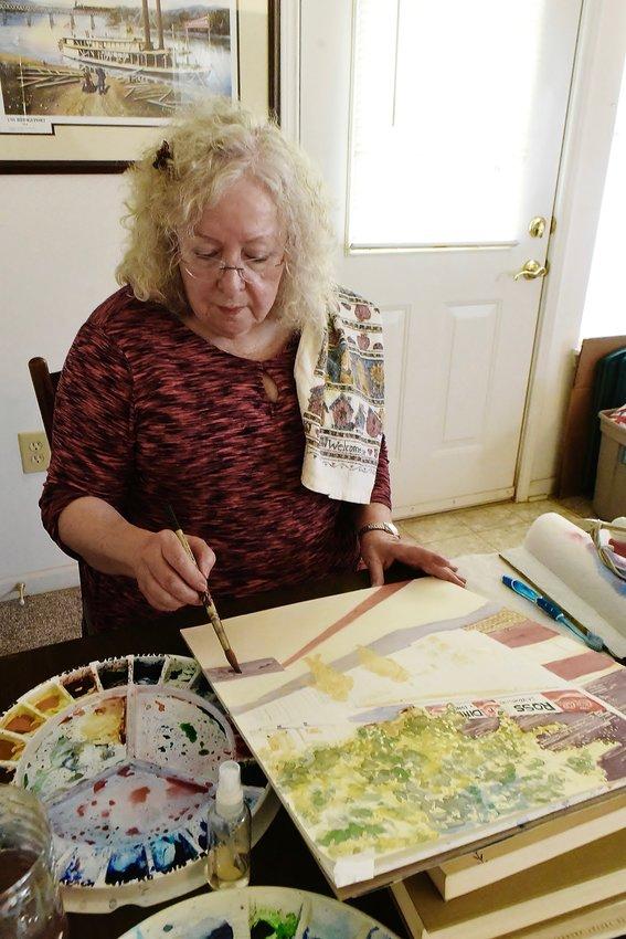 A self-taught artist, Jodeen Blazer Brown creates a watercolor painting.