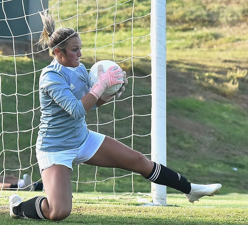 Adairsville senior Havyn Isaac makes a save during a Class 3A state tournament first-round match with Lumpkin County Wednesday at Tiger Valley.