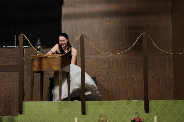 "Performing a scene from ""Little Women: The Broadway Musical,"" Grace Weeks as Jo March writes in her attic."