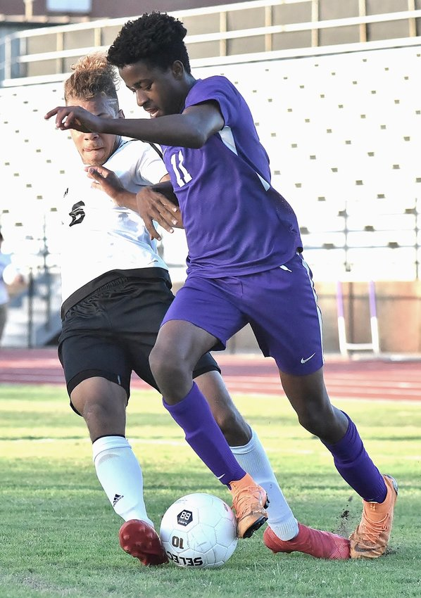 Cartersville junior Pedro Ghanem attempts to beat a Madison County defender during Friday's match in the first round of the Class 4A state tournament at Weinman Stadium. Ghanem scored twice to help the Canes ease to a 5-1 victory.