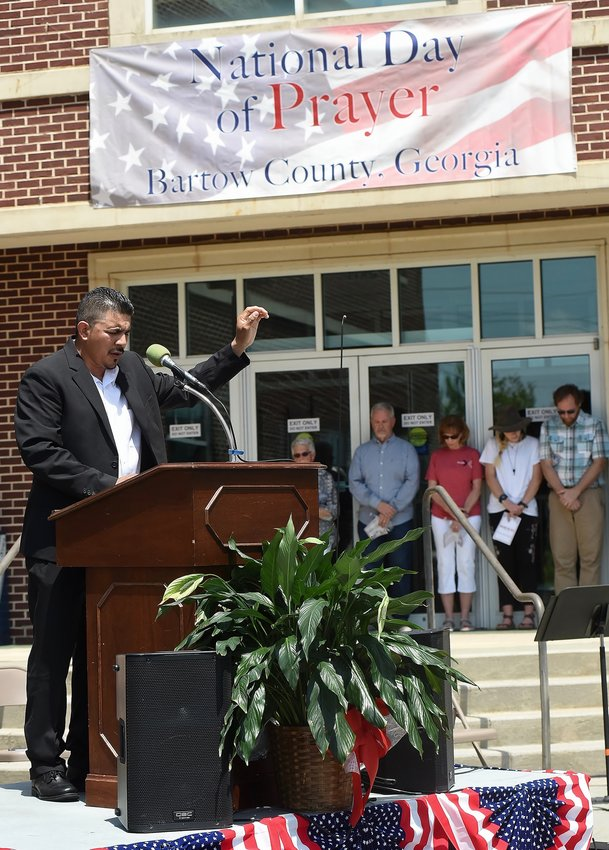 The Rev. Eduardo Vera delivers a prayer of reconciliation in Spanish at 2019's National Day of Prayer ceremonies in Cartersville.