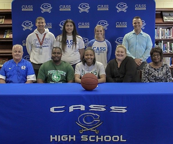 Cass senior Alexis Ware recently signed to play basketball with Piedmont College in Demorest. On hand for the signing were, from left, front row, CHS athletics director Nicky Moore; Anthony Ware, father; Misty Perdue, aunt; Laura Ware, grandmother; back row, Burt Jackson, CHS head coach; Ashley Huskins, CHS assistant coach; Taylor Weeks, CHS assistant coach; and Stephen Revard, CHS principal.
