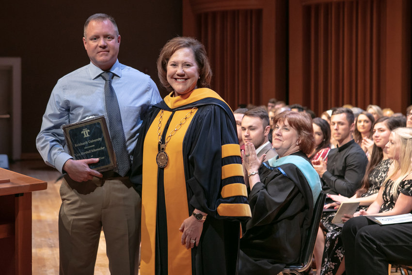 Lt. Mark Anderson of Rydal is congratulated by Reinhardt University President Dr. Kina S. Mallard on winning the Nontraditional Student of the Year Award last month.