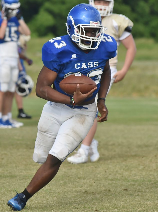 Cass rising sophomore running back Jaheim Cartwright heads upfield during a spring practice Monday. For the first time in head coach Bobby Hughes' tenure, the Colonels will face an outside opponent in a scrimmage to conclude spring workouts, when they welcome Creekview for a 7:30 p.m. contest Friday at Doug Cochran Stadium.