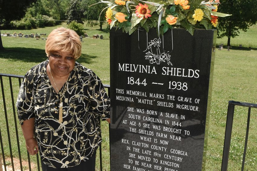 Nellie Applin, next to the monument recognizing Melvinia Shields in the Queen Chapel Independent Methodists Church's cemetery in Kingston, was inducted into the Martin Luther King, Jr. Legacy & Leadership Academy last month.