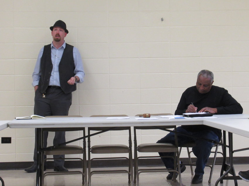 From left, Bartow County Elections Supervisor Joseph Kirk speaks at Monday's Active Bartow County Democrats' gathering at the Cartersville Civic Center, with Dr. Randy Ford presiding over the meeting.