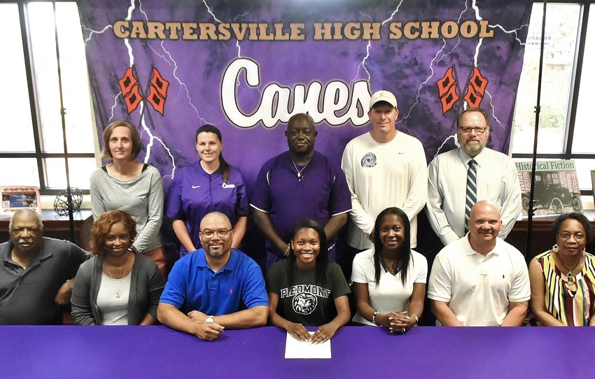 Cartersville High School senior Demya Bryan signed to run track at Piedmont College in Demorest. On hand for the signing were, from left, front row, Franklin Ware, grandfather; Chaka Bryan, stepmother; Demond Bryan, father; LaShun King, mother; Shane King, stepfather; and Gloria Ware, grandmother; back row, Shelley Tierce, CHS principal; Shannon Suarez, assistant track coach; Emerson Bridges, head track coach; Matt Terry, coach; and Darrell Demastus, CHS athletic director.