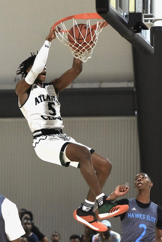 Atlanta Celtics point guard Deivon Smith dunks during a game in the adidas Memorial Day Classic Saturday at LakePoint. Smith, a rising senior at Grayson High, is ranked fourth in the state in the Class of 2020.