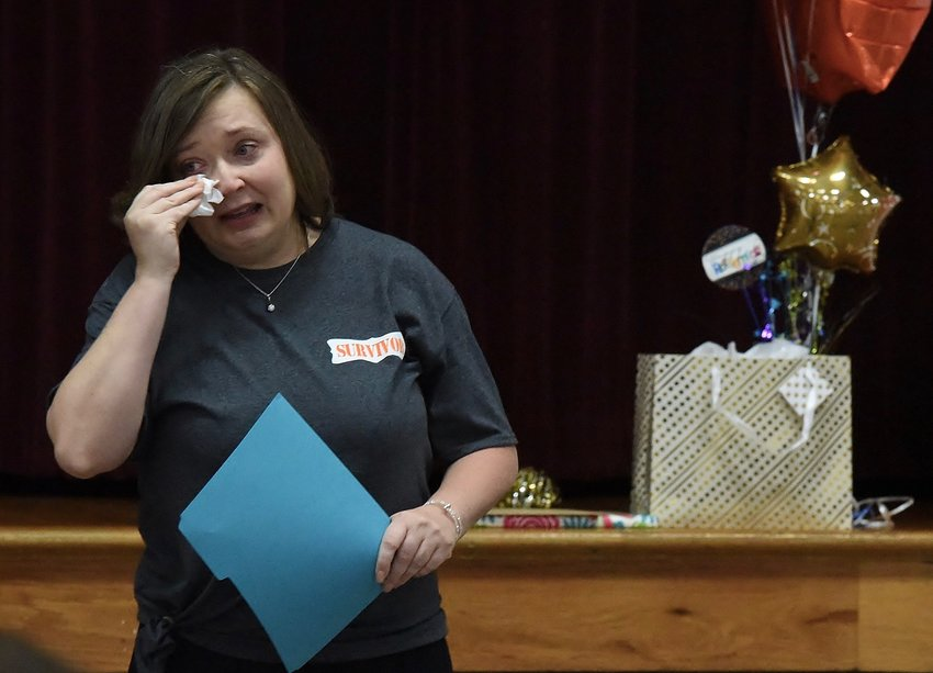 An emotional Tia Windsor, retiring South Central Middle School principal, speaks at her retirement celebration in the school cafeteria Thursday.