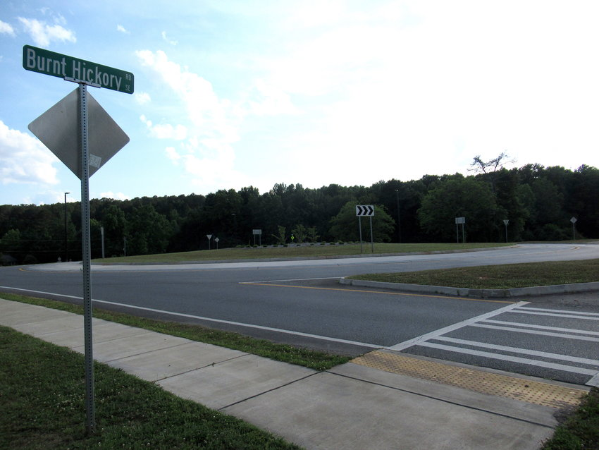 The Bartow-Cartersville Land Bank board voted unanimously Wednesday to approve the acquisition of about 8 acres of land — with some conditions — surrounding the Burnt Hickory Road roundabout.