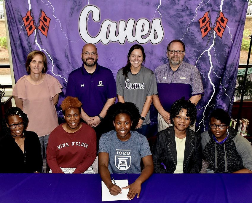 Recent Cartersville High graduate Nedu Evans signed to play volleyball with Augusta University. On hand for the signing were, from left, front row: Dalu Evans, sister; Odera Anokwalu-Igwebnike, sister; Rita Evans, mother; Dingo Evans, sister; back row, Shelley Tierce, CHS principal; Dutch Cothran, CHS head volleyball coach; Kady Doegg, CHS assistant volleyball; and Darrell Demastus, CHS athletic director.